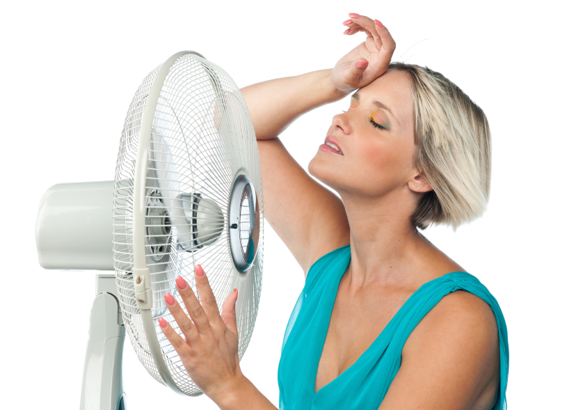 woman cooling herself with electric fan