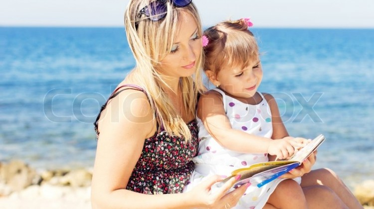 2567882-loving-mother-and-daughter-reading-book-on-the-beach