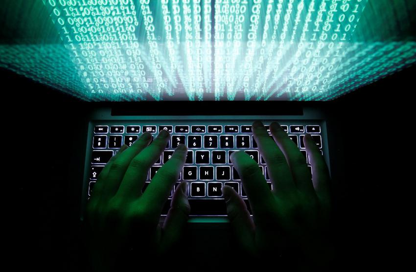 "A man types on a computer keyboard in Warsaw in this February 28, 2013 illustration file picture. One of the largest ever cyber attacks is slowing global internet services after an organisation blocking ""spam"" content became a target, with some experts saying the disruption could get worse. To match INTERNET-ATTACK/ REUTERS/Kacper Pempel/Files (POLAND - Tags: BUSINESS SCIENCE TECHNOLOGY)"
