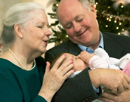 grandma-and-grandpa-holding-baby