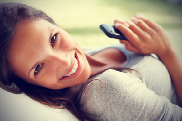 happy-young-girl-holding-her-cell-phone