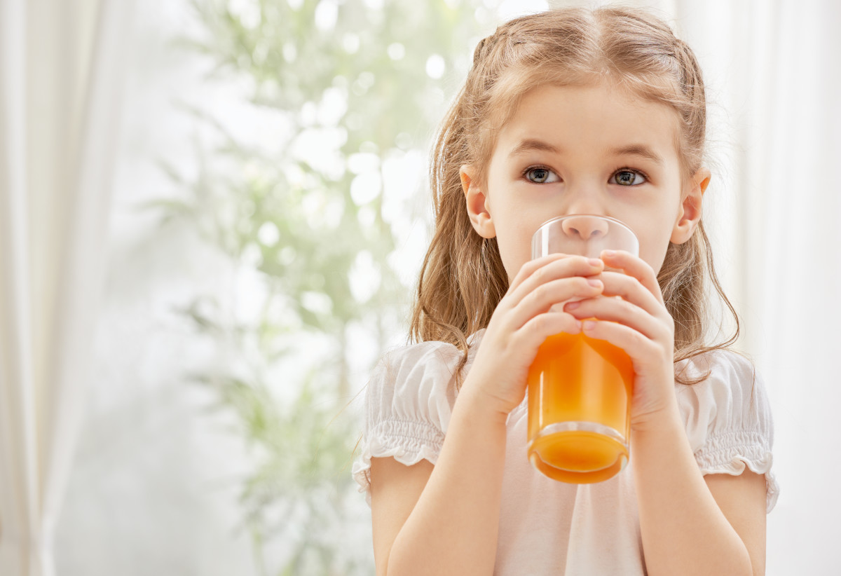 A beautiful girl drinking fresh juice